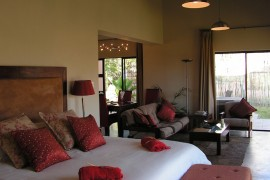 Hoopoe Cottage interior - the bed and lounge area
