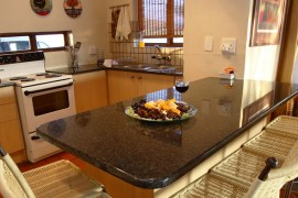 One of the Kitchen's, stove,microwave and granite table