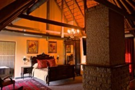 A bedroom at Inkungu Lodge